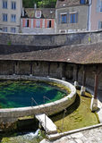 Tonnerre France. Tonnerre in the Morvan, Burgundy, France sits on the River Armancon. Famed for theTonnerre Fosse Dionne wash house Royalty Free Stock Photo