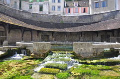 Tonnerre France. Tonnerre in the Morvan, Burgundy, France sits on the River Armancon. Famed for theTonnerre Fosse Dionne wash house Stock Photos