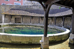 Tonnerre France. Tonnerre in the Morvan, Burgundy, France sits on the River Armancon. Famed for theTonnerre Fosse Dionne wash house Stock Images