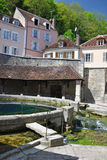 Tonnerre France. Tonnerre in the Morvan, Burgundy, France sits on the River Armancon. Famed for theTonnerre Fosse Dionne wash house Royalty Free Stock Photography