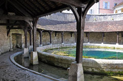 Tonnerre France. Tonnerre in the Morvan, Burgundy, France sits on the River Armancon. Famed for theTonnerre Fosse Dionne wash house Royalty Free Stock Images