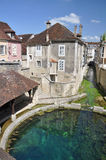 Tonnerre France. Tonnerre in the Morvan, Burgundy, France sits on the River Armancon. Famed for theTonnerre Fosse Dionne wash house Stock Photography