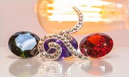 tono caliente número nueve con las piedras preciosas coloridas Imagenes de archivo