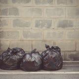 Tono d'annata delle borse di immondizia di plastica nere Immagine Stock Libera da Diritti