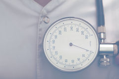 Tonometer on a background of white coat of doctor Stock Images