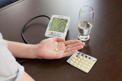 Tonometer in the man's hands. The man measures to himself a blood pressure at home Stock Photography