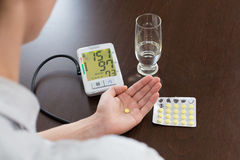 Tonometer in the man's hands. The man measures to himself a blood pressure at home Stock Images