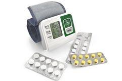 Tonometer with pills Royalty Free Stock Photo