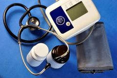 Tonometer and stethoscope medical diagnostic devices. Stethoscope diagnostic device for listening to sounds from the heart, blood vessels, lungs and bronchi stock photography