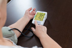 Tonometer in the woman's hands. The woman measures to herself a blood pressure Royalty Free Stock Photos