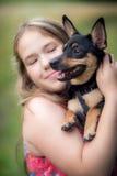 Tonårig flicka och hund Arkivbild