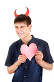 Tonåring med jäkelhorn och hjärta Royaltyfri Fotografi