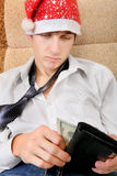 Tonåringen kontrollerar plånboken Royaltyfri Fotografi