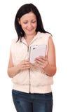 Tonårs- flicka med tableten Royaltyfria Foton