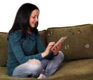 Tonårs- flicka med tabletPC Royaltyfria Foton