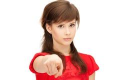 Tonårs- flicka som pekar hennes finger Royaltyfri Foto