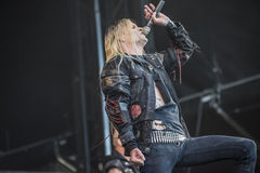 Tons of Rock, Kampfar (day 3). Kampfar is a black metal band from Fredrikstad, Norway. According to their singer, Dolk, their name is an ancient Norse battle cry Royalty Free Stock Photo