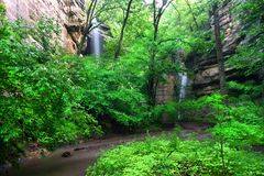 Tonti Canyon Falls Illinois. Beautiful waterfalls flow into Tonti Canyon on a spring day at Starved Rock State Park Royalty Free Stock Images