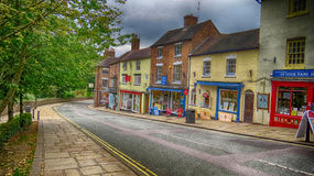 Tontine Hill Ironbridge. Shops on Tontine Hill in the town of Ironbridge Shropshire home to the Worlds first bridge made of Iron Stock Images