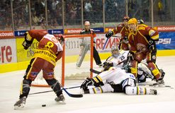 Tony SALMELAINEN - GSHC. Tony Salmelainen, Jean-Pierre Vigier & Hoehener Martin trying to put the 4th goal for GSHC at the Les Vernet arena in Geneva Royalty Free Stock Photography