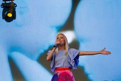 Tonya Matvienko, Ukrainian singer emotionally sings, portrait at live concert in Pobuzke, Ukraine, 15.07.2017, editorial photo Stock Image