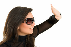 Too bright. Young adult pretty girl in sun glasses on white Royalty Free Stock Photos