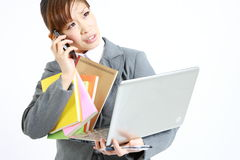 Too busy business woman. Concept shot of Japanese businesswoman Royalty Free Stock Photography