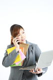 Too busy business woman. Concept shot of Japanese businesswoman Royalty Free Stock Images