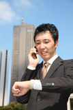 Too busy businessman. Concept shot of Japanese businessman Stock Images