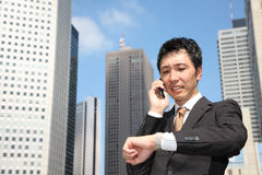 Too busy businessman. Concept shot of Japanese businessman Royalty Free Stock Images