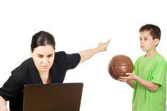 Too busy mother. Busy mother who don't have time to play with her son Stock Photos