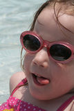 Too cool. A four year old girl enjoying the pool Stock Photo