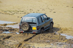 In too deep. A 4x4 sinks slowly backwards into quicksand royalty free stock image