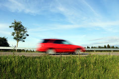 Too fast driving by car on the road. Lawn on German roads. Too fast driving by car on the road. Too fast driving on the road Stock Image