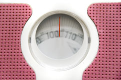 Too heavy. A bathroom weighing machine, motion blur showing the weight going higher than 100 kilos stock images