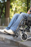Too high. Man on a wheelchair who came to a bareer Royalty Free Stock Photography
