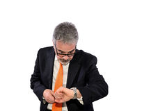 Too late. Businessman looks at his watch because he has made of the appointment Stock Images