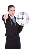 Too late concept. Businesswoman holding clock, too late concept Royalty Free Stock Photo