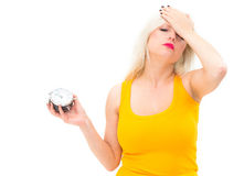 Too late,young beautiful woman holding a clock. On a white background Stock Image