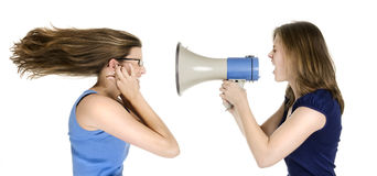 Too loud. Two girls with megaphone symbolizing loudness Stock Image