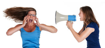 Too loud. Two girls with megaphone symbolizing loudness Royalty Free Stock Photography