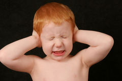 Too Loud. Boy covering ears Royalty Free Stock Images