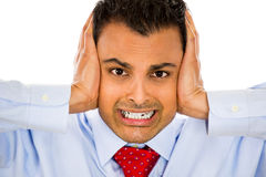 This is too loud!. Closeup portrait of man holding hands to ears covering to shut out noise, isolated on white background Royalty Free Stock Photography