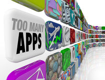 Too Many Apps Software Programs Oversupply Glut Surplus. The words Too Many Apps on a tile in a wall full of software application icons illustrating an Royalty Free Stock Photos