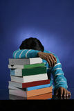 Too many books to study. Teenager depressed over so many books to study Stock Photography