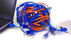 Too many cables. Access point, RJ45 connectors and ethernet cables knot royalty free stock image