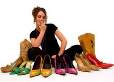 Too many Choices!. Young pretty lady trys to decide what shoes to wear, decisions Stock Photos