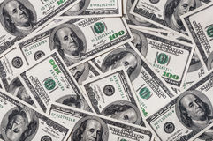Too many dollars. A pile of hundred dollar bills. Background stock photos