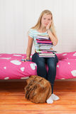 Too many homework. Fourteen year old girl with many school books and too many homework Royalty Free Stock Photography
