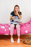 Too many homework. Fourteen year old girl with many school books and too many homework Stock Images